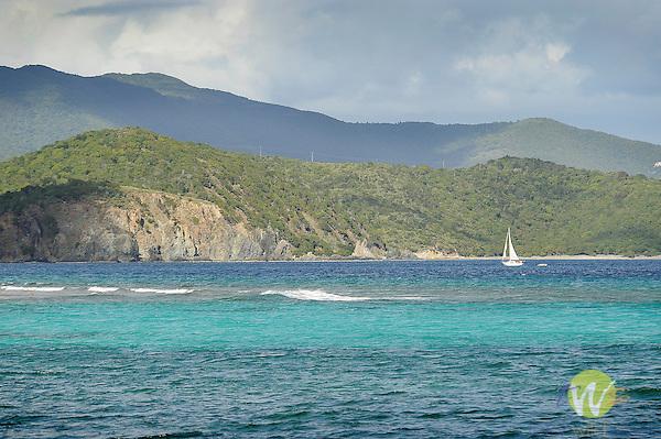 St. John, British Virgin Islands, Friis Bay looking toward East End of Island with sailboat.
