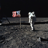 "The Moon - (FILE) -- Astronaut Buzz Aldrin, lunar module pilot of the first lunar landing mission, poses for a photograph beside the deployed United States flag during an Apollo 11 Extravehicular Activity (EVA) on the lunar surface on Sunday, July 20, 1969. The Lunar Module (LM) is on the left, and the footprints of the astronauts are clearly visible in the soil of the Moon. Astronaut Neil A. Armstrong, commander, took this picture with a 70mm Hasselblad lunar surface camera. While astronauts Armstrong and Aldrin descended in the LM, the ""Eagle"", to explore the Sea of Tranquility region of the Moon, astronaut Michael Collins, command module pilot, remained with the Command and Service Modules (CSM) ""Columbia"" in lunar-orbit. .Credit: NASA via CNP"