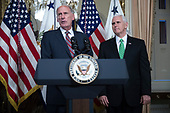 Director of National Intelligence Dan Coats (L), with United States Vice President Mike Pence (R), delivers remarks during a swearing in ceremony in the US Capitol in Washington, DC, USA, 16 March 2017.<br /> Credit: Shawn Thew / Pool via CNP