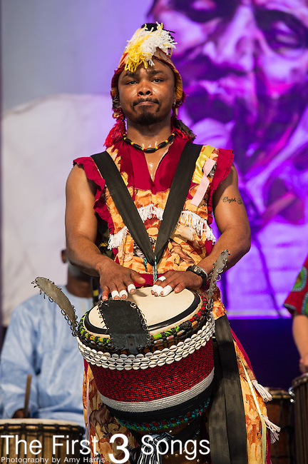 Ivoire Spectacle featuring Seguenon Kone performs during the New Orleans Jazz & Heritage Festival in New Orleans, LA.