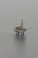 An oil industry platform stands in Cook Inlet, offshore from Nikiski, Alaska. Oil and natural gas are an important contributor to the Kenai Peninsula's economy.