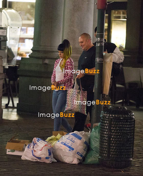 EXCLUSIVE - Lily Allen arrived from Hamburg , Germany, at the Brussels airport in Belgium around noon time, before heading to the 'Videohouse', for a private concert organised by NRJ Radio station, in front of only two hundred people.<br /> Following the concert, Lily Allen went to downtown Brussels to the famous belgian restaurant ' La Taverne du Passage'.<br /> May 27, 2014.<br /> Pic : Lily Allen coming out of '' La Taverne du Passage'. restaurant