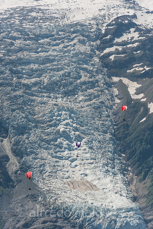 Paragliding below summit of Mont Blanc, Chamonix, Haute-Savoie, French Alps, France