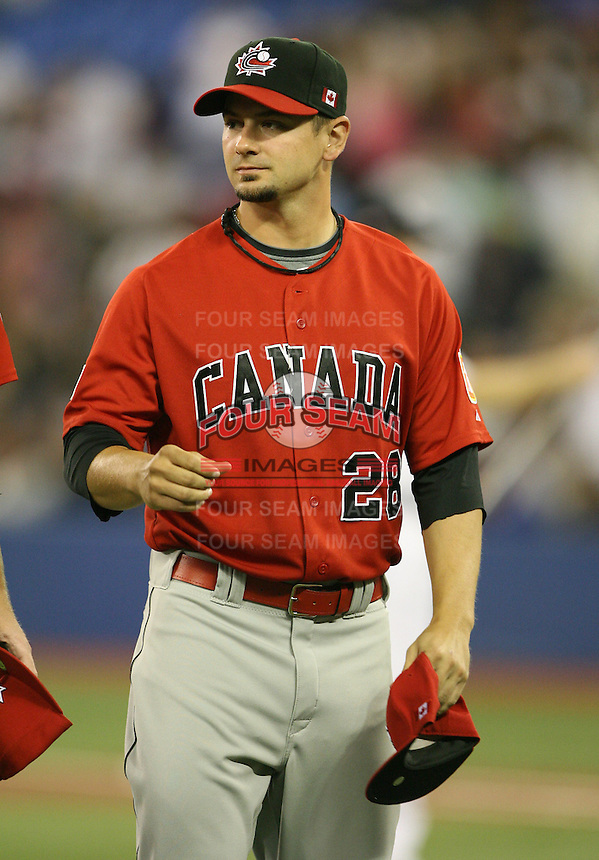 March 7, 2009:  Pitcher Jesse Crain (23) of Canada during the first round of the World Baseball Classic at the Rogers Centre in Toronto, Ontario, Canada.  Team USA defeated Canada 6-5 in both teams opening game of the tournament.  Photo by:  Mike Janes/Four Seam Images