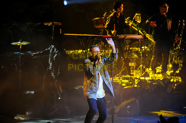 Macklemore (Ben Haggerty) and Ryan Lewis performing in concert, Brixton Academy, London, England. <br /> 9th September 2013<br /> on stage in concert live gig performance performing music half length shirt singing profile side grey gray hand arm in air<br /> CAP/MAR<br /> &copy; Martin Harris/Capital Pictures