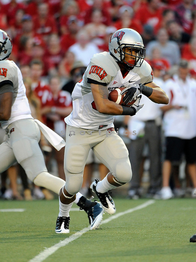 TIM CORNETT, of the UNLV Rebels in action during the Rebels game against the Wisconsin Badgers on September 1, 2011 at Camp Randall Stadium in Madison, WI. Wisconsin beat UNLV 51-17.