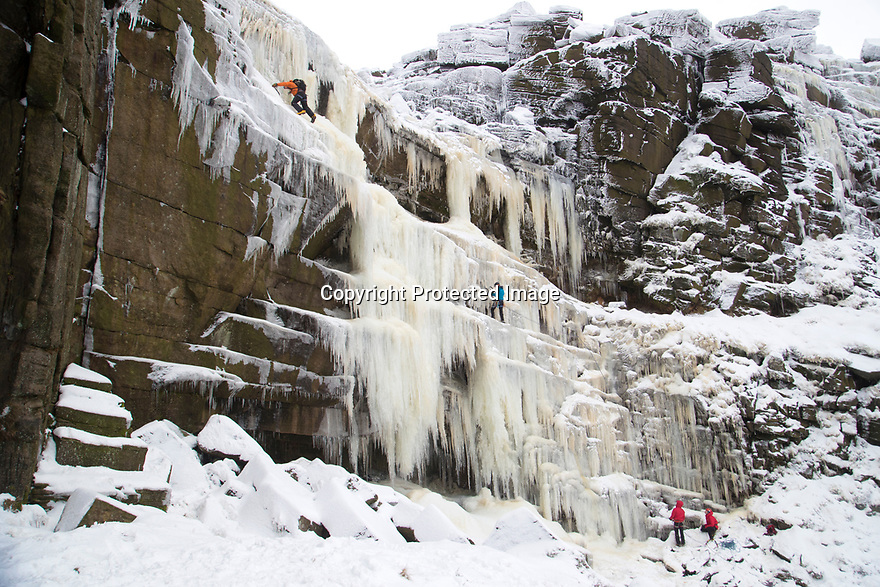03/01/19<br /> <br /> After one of the coldest nights of the year, ice climbers make their way up the frozen face of Kinder Downfall which is normally a 30 metre high waterfall that flows off Kinder Scout in the Derbyshire Peak District.<br /> <br /> All Rights Reserved, F Stop Press Ltd +44 (0)7765 242650  www.fstoppress.com rod@fstoppress.com