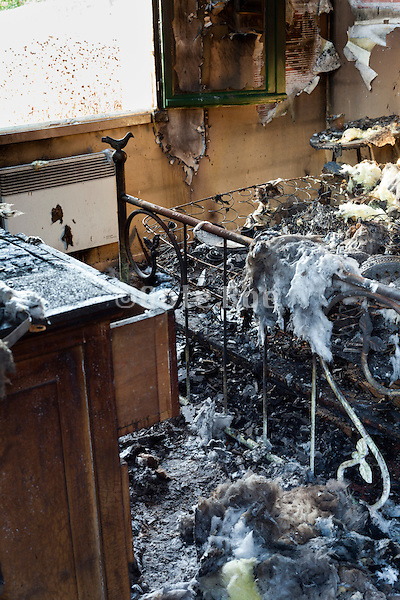 total burned out remains of bedroom in residential house