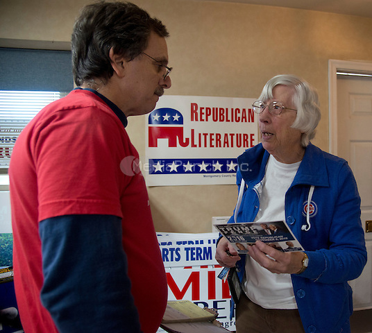 Rockville,MD November 7 2016, USA:  In the final day of the Presidential elections, the Montgomery County, MD Republican campaign headquarters has signs and political material ready to hand out to supporters. Brad Botwin, the Mongtomery County, MD Republican Events Chairman talks to an unidentified voter in the campaign office.  Patsy Lynch/MediaPunch