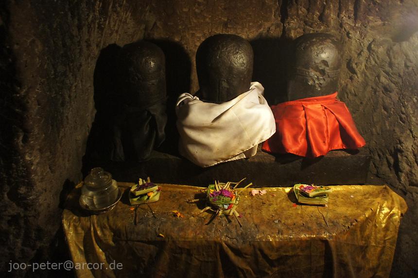 The three Lingas represent trimurti, three gods, Shiva (white) Vishnu (black) and Brahma (red)