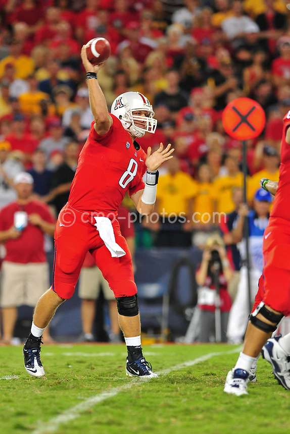 ept 18, 2010; Tucson, AZ, USA; Arizona Wildcats quarterback Nick Foles (8) throws a pass in the 2nd quarter of a game against the Iowa Hawkeyes at Arizona Stadium.