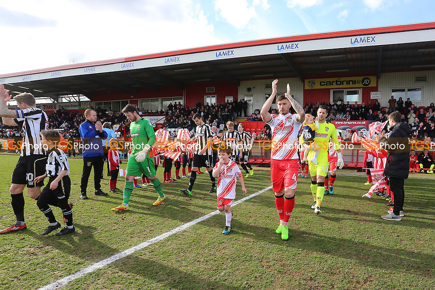 The teams take to the field during Stevenage vs Notts County, Sky Bet EFL League 2 Football at the Lamex Stadium on 4th March 2017