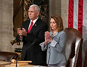United States Vice President Mike Pence, left, and Speaker of the US House of Representatives Nancy Pelosi (Democrat of California), right, applaud prior to the arrival of Jens Stoltenberg, Secretary General of the North Atlantic Treaty Organization (NATO) who will address a joint session of the United States Congress in the US Capitol in Washington, DC on Wednesday, April 3, 2019.<br /> Credit: Ron Sachs / CNP