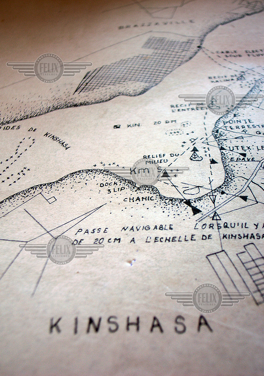 A map in a guidebook of the River Congo containing detailed illustrations and information about the geographical features along the route from Kinshasa to Kisangani..