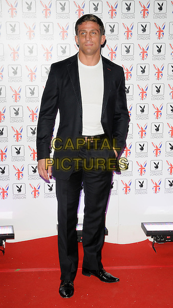 Alex Reid .At the opening of the Playboy Club, Old Park Lane, Mayfair, London, England, UK, June 4th 2011..Full length black suit white t-shirt Hermes belt .CAP/CAN.©Can Nguyen/Capital Pictures.