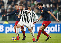 Calcio, Serie A: Juventus - Genoa, Torino, Allianz Stadium, 22 gennaio 2018. <br /> Juventus Gonzalo Higuain (c) in action with Genoa's Andrea Bertolacci (l) and Nicolas Spolli (r) during the Italian Serie A football match between Juventus and Genoa at Torino's Allianz stadium, January 22, 2018.<br /> UPDATE IMAGES PRESS/Isabella Bonotto