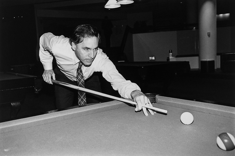 Rep. Cliff Stearns, R-Fla., plays a game of pool after a meeting on March 21, 1991. (Photo by Laura Patterson/CQ Roll Call via Getty Images)