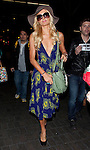 ..March 27th 2012 ..Paris Hilton wearing a big hat & sunglasses blue & yellow dress as she arrives at the L.A.X los angeles airpot with DJ Arab. Paris was flying to Australia. Paris was carrying a green designer alligator crocodile snake skin purse handbag ..AbilityFilms@yahoo.com.805-427-3519.www.AbilityFilms.com....