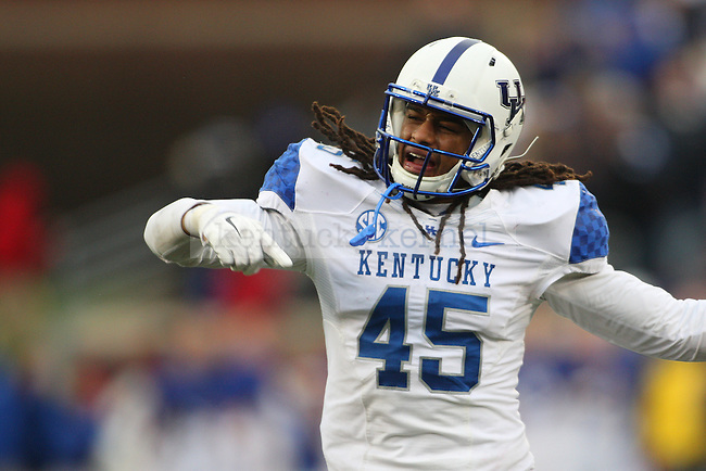 Linebacker Josh Forrest of the Kentucky Wildcats celebrates a sack during the second half of the game against the Louisville Cardinals at Papa Johns Cardinals Stadium on Saturday, November 29, 2014 in Louisville, Ky. Louisville defeated Kentucky 44-40. Photo by Michael Reaves | Staff