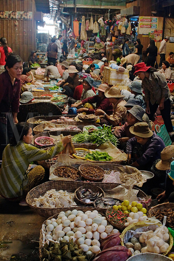 Vegetables and much more are for sale at the local covered market in Siem Reap the gateway to Angkor Wat -  Cambodia.