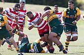 Lepetimalo Lauese gets hit in a strong tackle from Petelo Sili. Counties Manukau Premier Counties Power Club Rugby game between Karaka and Pukekohe, played at the Karaka Sports Park on Saturday March 10th 2018. Pukekohe won the game 31 - 27 after trailing 5 - 20 at halftime.<br /> Photo by Richard Spranger.
