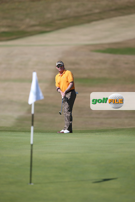 Miguel Angel Jimenez (ESP) makes heavy work on the 6th during Round Two of the 2014 Senior Open Championship presented by Rolex from Royal Porthcawl Golf Club, Porthcawl, Wales. Picture:  David Lloyd / www.golffile.ie