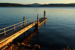 A lakeside dock invites swimmers to the Beautiful blue waters of lake Coeur D Alene, Idaho
