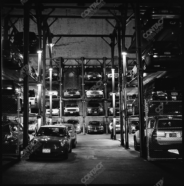An attendant parked cars at a four level parking lot on Lafayette Street in Soho, New York. New York City, New York, November 14, 2008
