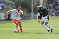 Blackpool's Ryan McLaughlin under pressure from Plymouth Argyle's Gary Sawyer<br /> <br /> Photographer Kevin Barnes/CameraSport<br /> <br /> The EFL Sky Bet League One - Plymouth Argyle v Blackpool - Saturday 15th September 2018 - Home Park - Plymouth<br /> <br /> World Copyright &copy; 2018 CameraSport. All rights reserved. 43 Linden Ave. Countesthorpe. Leicester. England. LE8 5PG - Tel: +44 (0) 116 277 4147 - admin@camerasport.com - www.camerasport.com