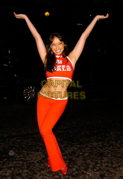 LUCINDA RHODES-FLAHERTY.The Home Run Baseball themed party, Embassy Club, London, UK..November 12th, 2006.Ref: CAN.full length red orange trousers cropped belly stomach midriff news of the world arms in air.www.capitalpictures.com.sales@capitalpictures.com.©Can Nguyen/Capital Pictures