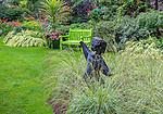 Vashon-Maury Island, WA: Springstone sculpture set among perennial grasses in a summer garden