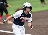 NWA Democrat-Gazette/CHARLIE KAIJO Rogers Heritage High School Kyliee Germann (16) scores during the 6A State Softball Tournament, Thursday, May 9, 2019 at Tiger Athletic Complex at Bentonville High School in Bentonville. Rogers Heritage High School lost to Northside High School 8-6