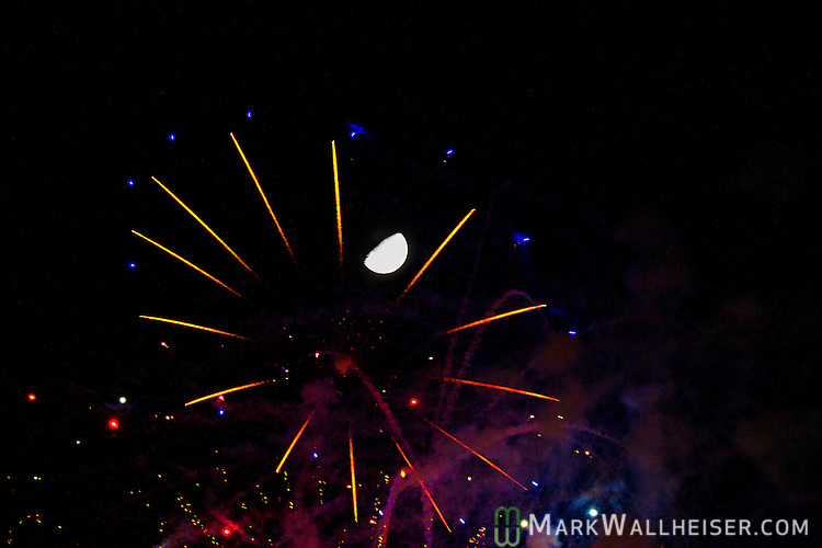 The moon shines through the fireworks over the Set during the Student Government Inaugural/Founders' Day kick-off party on the set at FAMU campus in Tallahassee, FL October 2, 2014.   The Founders' Day Kick-off was part 2014  Presidential Inauguration of Dr Elmira Mangum at FAMU's 11th president.