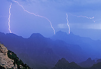 749220242 a summer monsoon storm puts on a lightning show over the canyon seen from the north rim of grand canyon national park in northern arizona