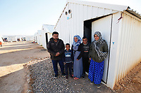 Yasser and his wife Bahryeh with their 3 children, Mohammed, Abdullah and Amal, pictured outside their one-roomed shelter in the Azraq camp for Syrian refugees in nothern Jordan. They come from Deir-ez-zor in Syria and arrived in Azraq in April 2016.<br /> <br /> Before leaving Syria they had been internally displaced for over three years, moving four times inside the country to escape the fighting. One of the boys has a medical condition that requires a medical check up every three months. This was the main reason that Yasser and Bahryeh finally decided to leave Syria as the access to medical facilities was getting harder and they could not get treatment for their son.<br /> <br /> Yasser used to work as a barber in Syria, but has now trained as an electrical engineer in Azraq, helping to connect shelters in the camp to the electricity grid. He hopes to go back to Syria one day, but in the meantime hopes to also open a barber shop in Jordan if he can.<br /> <br /> The family receives a monthly $175 cash assistance grant via UNHCR, as part of a programme which is co-funded by the UK and other donors. This helps towards living costs, meaning families can choose what they need to spend the money on. Cash assistance is increasingly seen as a more cost-effective way of providing humanitarian aid in a protracted crisis, as every family has different needs and circumstances.<br /> <br /> Picture: Russell Watkins/DFID