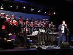 St Peters Choir on stage with conductor Edward Holly at the tribute to Larry Delaney show in The Barbican Centre. Photo:Colin Bell/pressphotos.ie