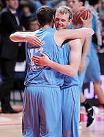 Asefa Estudiantes' Fran Guerra (l) and Daniel Clark celebrates the victory after Liga Endesa ACB match.January 13,2012. (ALTERPHOTOS/Acero)