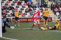Billy Kee of Accrington Stanley is tackled by Janoi Donacien of Newport County during the Sky Bet League 2 match between Newport County and Accrington Stanley at Rodney Parade, Newport, Wales on 28 March 2016. Photo by Mark  Hawkins.