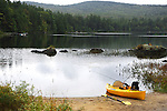 Kayak waiting on the beach for a lake adventure in New Hampshire USA