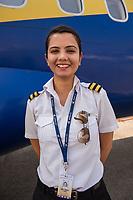 Nepal, Kathmandu. Woman pilot on Buddha Air.