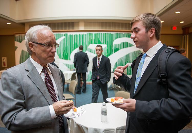 College of Business student, Tucker Skove, speaks with a professor before the Walter Center for Strategic Leadership Speaker Series in the Baker Center Theater, on September 10, 2013.