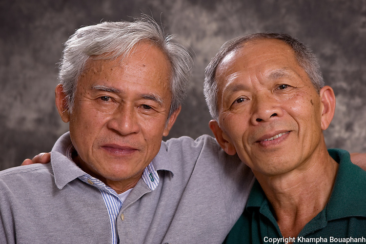 Legendary singer/composers Voradeth Ditthavong, left, and Silavong Keo, photographed during the Lao Artists Festival in Elgin, IL on August 20, 2010.  (photo by Khampha Bouaphanh)