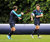 Bagshot, England. Lee Dickson passes to Ben Foden of England during the England training session held at Pennyhill Park on October 31, 2013 in Bagshot, England.