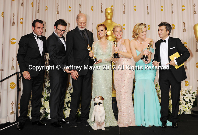 HOLLYWOOD, CA - FEBRUARY 26: Jean Dujardin, Michel Hazanavicius, James Cromwell, Uggie the dog, Berenice Bejo, Penelope Ann Miller, Missi Pyle and Thomas Langmann pose in the press room at the 84th Annual Academy Awards held at Hollywood & Highland Center on February 26, 2012 in Hollywood, California.