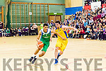Ryan Leonard, Tralee Worriors gets past Eoin Darling DCU Saints and drives toward the board during the basketball game last Saturday night in Tralee.
