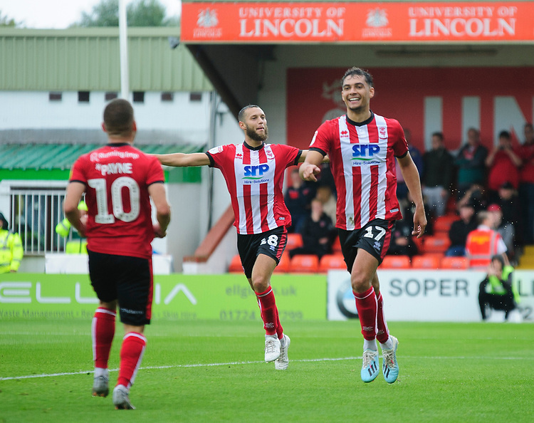 Lincoln City's Tyler Walker celebrates scoring the opening goal<br /> <br /> Photographer Andrew Vaughan/CameraSport<br /> <br /> The EFL Sky Bet League One - Lincoln City v Fleetwood Town - Saturday 31st August 2019 - Sincil Bank - Lincoln<br /> <br /> World Copyright © 2019 CameraSport. All rights reserved. 43 Linden Ave. Countesthorpe. Leicester. England. LE8 5PG - Tel: +44 (0) 116 277 4147 - admin@camerasport.com - www.camerasport.com