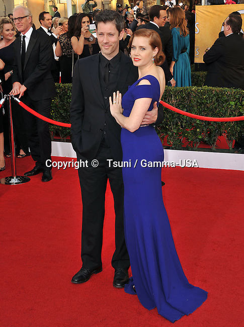 Amy Adams, Darren Le Gallo  arriving at the 20th SAG Awards 2014 at the Shrine Auditorium in Los Angeles.