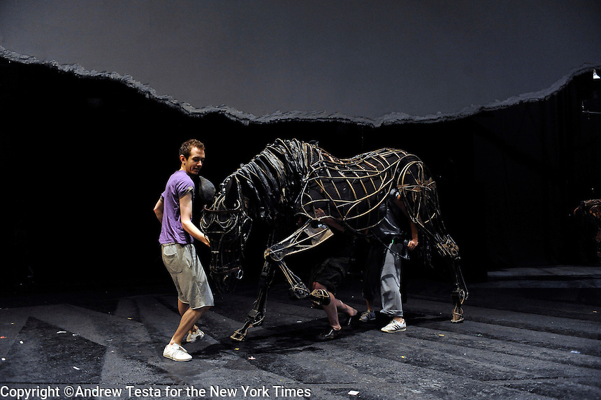 UK. London. 8th July 2009.Puppeteers Laura Cubitt , Finn Caldwell  and Toby Olie controlling a horse  during a rehearsal of War Horse..©Andrew Testa for the New York Times