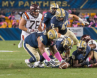 Pitt defensive lineman Khaynin Mosley-Smith (95) recovers a fumble. The Pitt Panthers defeated the Virginia Tech Hokies 21-16 at Heinz Field, Pittsburgh Pennsylvania on October 16, 2014