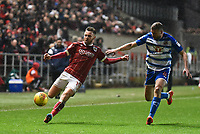 Matty Taylor of Bristol City is challenged by Joey van den Berg of Reading  during the Sky Bet Championship match between Bristol City and Reading at Ashton Gate, Bristol, England on 26 December 2017. Photo by Paul Paxford.